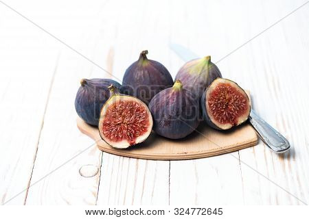 Fresh Ripe Figs On A White Wooden Table. Healthy Mediterranean Figs. Beautiful Blue Purple Figs, Sel