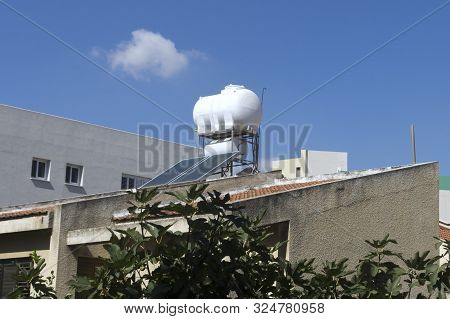 Solar water heater on a rooftop in Limassol, Cyprus poster
