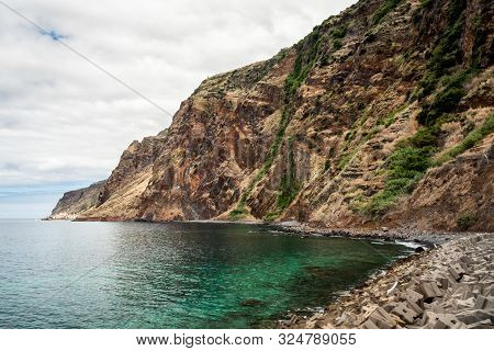 Beautiful And Idyllic Rocky Beach At The Foot Of A Mountain In The Island Of Madeira