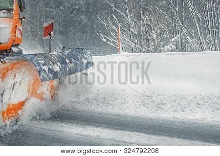 Snowplow Truck Removing Dirty Snow From City Street Or Highway After Heavy Snowfalls. Traffic Road S