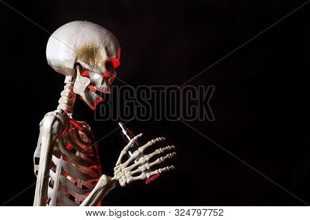 Skeleton Holding An Ecigarette With Danger Red Highlights Ready To Vape