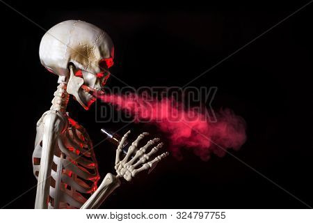 Skeleton Vaping Clouds Of Red Highlighted Vapor With An Ecigarette