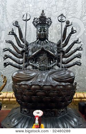 1000 hands Black Guan Yin statue in the temple poster