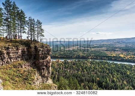 Irkutsk Region, Russia, Shamanka - September 22, 2019: People Are Staying On The Rock In The Forest