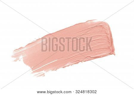 Color Corrector Stroke Isolated On White Background. Nude Pink Correcting Cream Concealer Smudge Sme