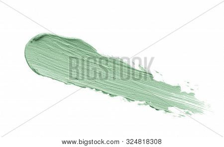 Color Correcting Concealer Stroke Isolated On White Background. Mint Green Corrector Cream Smudge Sm