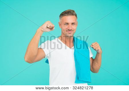 Handsome And Muscular. Handsome Man With Towel On Blue Background. Athlete Flex Biceps Triceps Arm.