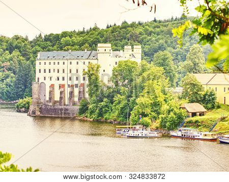 Orlik Castle Or Chateau Above Water Of Orlik Dam. Popular Schwarzenberg Medieval Stronghold. 11th Of