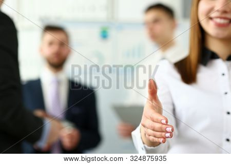 Focus On Pretty Female Reaching Tender Arm To Shake Hands With Biz Colleague Or Boss Manager To Gree