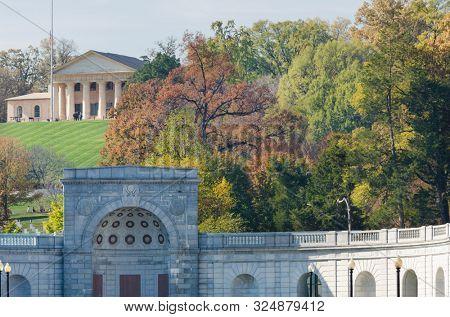 The entrance of Arlington National Cemetery and Arlington House in autumn foliage