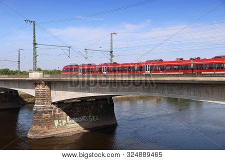 Dresden, Germany - May 10, 2018: Deutsche Bahn (german Railways) Train Crosses Marienbruecke (maria