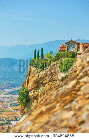 St. Stephen monastery on the rock in Meteora, Kalabaka, Thessaly, Greece - Greek landscape , copyspace conposition