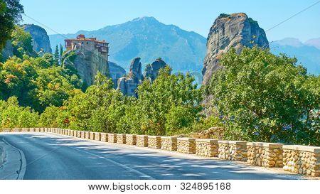 Road to Rousanou Nunnery on the rock in The Meteora, Kalabaka, Greece -  Picturesque greek landscape