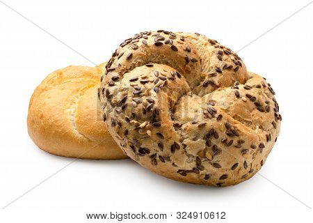 Whole Wheat Kaiser Roll With Seeds On Top Of Plain Kaiser Roll  Isolated On White.