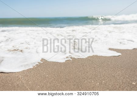Perfect Seascape. View From The Shore To A Hectic Sea With White Foam With A Clear Sunny Blue Sky. S