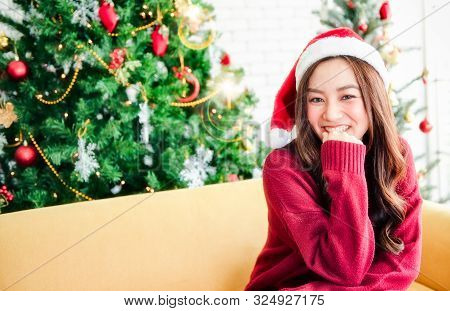 The Girl Smiles And Waiting For Christmas Gifts.