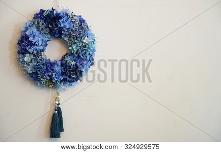 The blue garland which was hung on the wall of the room poster