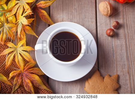 Cup Of Coffee, Autumn Leaves, Cookies On The Wooden Table. Autumn Harvest. Autumn Concept. Top View.
