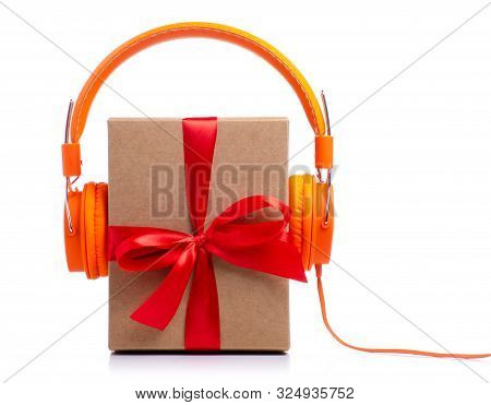 Christmas Music Concept. Gift With Headphones, Isolated On White Background