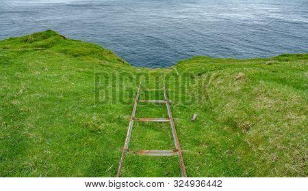 Rusty Abandoned Railroad Track Near The Ocean