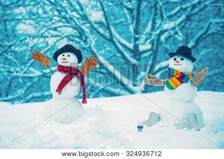 Snowman On A Background Snow-covered Fir Branches. Snowman In Snow Forest. Snowmen. Snowman Isolated