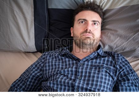 Man Having Problem Sleeping In His Bed