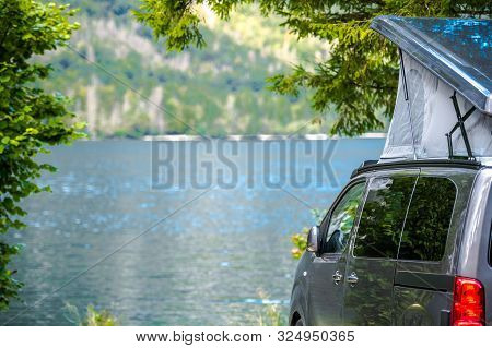 Lake Camping In The Van Rooftop Tent. Modern Camper Van In The Scenic Mountain Location.