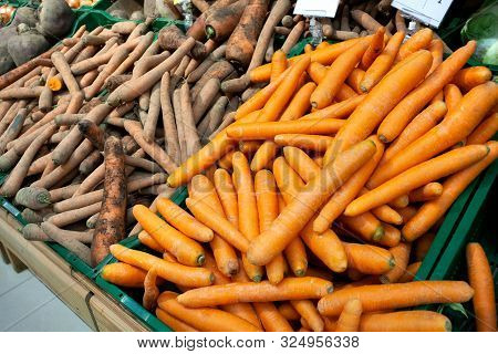 Washed And Unwashed Carrots In A Supermarket