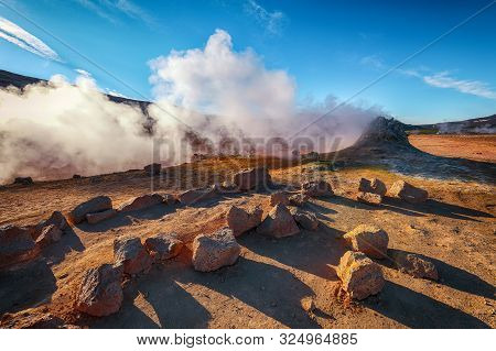 Steaming Cone In Hverir Geothermal Area With Boiling Mudpools And Steaming Fumaroles In Iceland  Loc