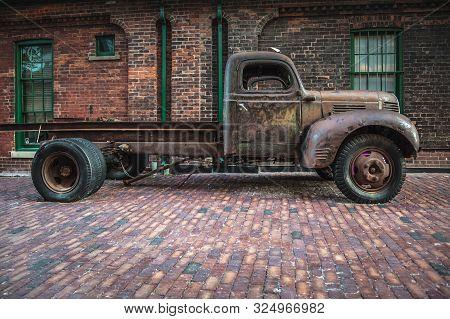 Distillery District , Toronto, Ontario, July 2014 - Old Truck On A Cobblestone Street Of Distillery