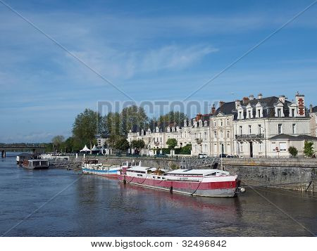 Docks Angers center in front of the medieval castle with white tuff buildings and barges. poster
