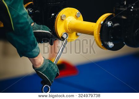 Hands Unscrew The Nut On The Screw Pipe
