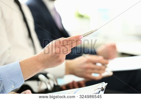 Focus On Attractive Female With Great Manicure Pointing At Something In Big Modern Office. Friendly