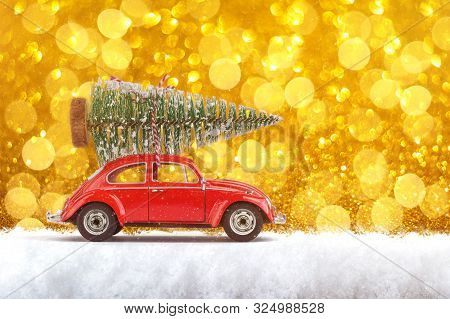 Severodvinsk, Russia, September 27, 2019. Holidays Concept. Little Classic Red Car Carrying Christma