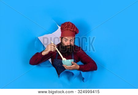 Healthy ration. Chef wear hat and apron looking through paper hole. Healthy food. Eat healthy. Man professional chef hold bowl and spoon. Dieting concept. Bearded chef in uniform. Cook preparing food poster