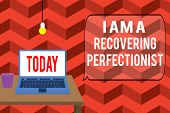 Writing note showing I Am A Recovering Perfectionist. Business photo showcasing Obsessive compulsive disorder recovery Front view open laptop lying on wooden desktop light bulb falling glass. poster