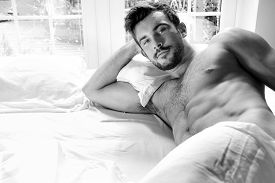 Sexy, Hairy Naked Muscular Man With Sixpack Abs Lying In Bed Covered With Sheet