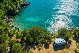 Aerial Photo Of Scenic Sea Front Rv Campsite. Modern Motorhome Camper Van On The Mediterranean Sea C