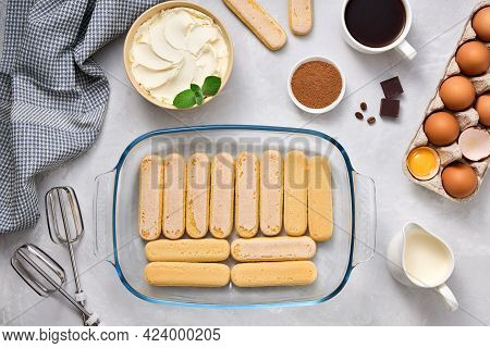 Product For Preparing Tiramisu Dessert. Top View Of Ingredients On A Light Background.
