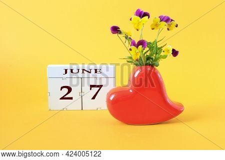 Calendar For June 27 : The Name Of The Month Of June In English, The Number 27 On Cubes, A Vase In T