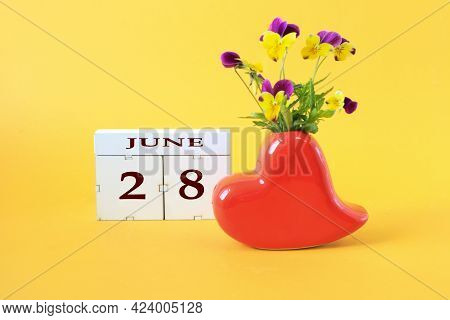 Calendar For June 28 : The Name Of The Month Of June In English, The Number 28 On Cubes, A Vase In T