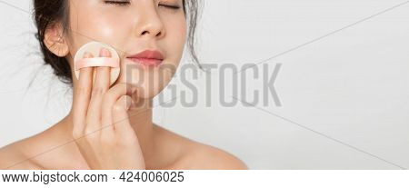 Beauty Makeup. Closeup Face Of Asian Woman Smile Looking Happy Applying Makeup With Puff Makeup To H