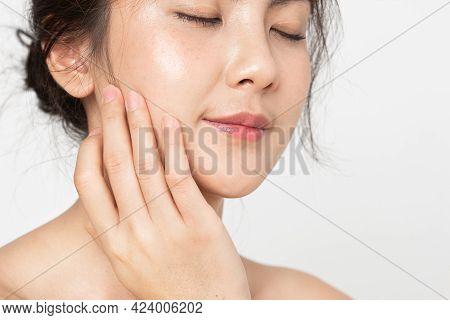 Closeup Beauty Skin Face.  Asian Woman With Beauty Face Touching Healthy Facial Skincare. Beautiful