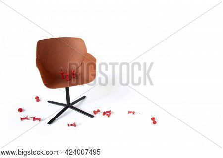 Chair With A Red Paper Pin On A White Background. Hemorrhoids Concept