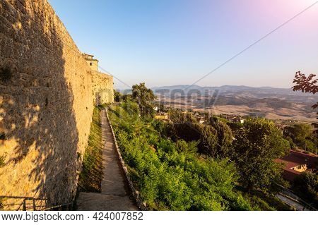 Volterra, Tuscany, Italy. August 2020. The Walls Of The Historic Village. The Warm Light Of The Late