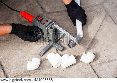 Pipes Of Sanitary Engineering Welded Plastic. Ppr Pipe Welding Tool