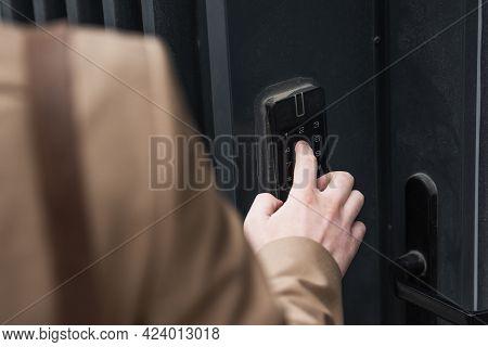 Cropped View Of Man Pressing Button On Intercom Keypad