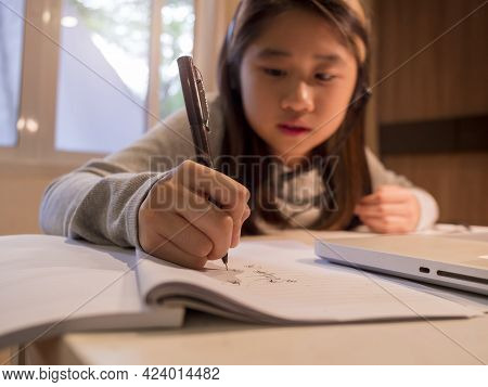 Close Up Hand Of  Asian Girl In Headphones Sit At Desk Study Online On Laptop. Kid Wear Headset Hand