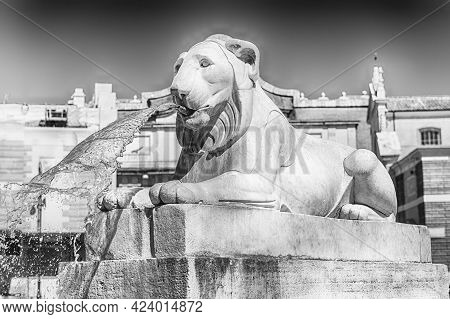 Statue In The Iconic Piazza Del Popolo, One Of The Main Squares And Landmarks In Rome, Italy