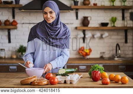 Gorgeous Arabian Woman Breaking The Egg To Whip It In A Bowl